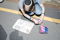 """Counterprotesters hold signs toward, flip-off, and angrily shout at those marching in the Straight Pride Parade in Boston, Massachusetts, on Sat., August 31, 2019. The parade was organized in reaction to LGBTQ Pride month activities by an organization called Super Happy Fun America.  The person's sign here reads """"No 2 Str8 hate!"""""""