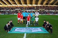 ATTENTION SPORTS PICTURE DESK<br /> Pictured: Alan Tate of Swansea City with Mascots<br /> Re: Coca Cola Championship, Swansea City Football Club v Nottingham Forest at the Liberty Stadium, Swansea, south Wales. Saturday 12 December 2009
