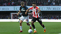 Ollie Watkins of Brentford in action as Middlesbrough's Lewis Wing looks on during Brentford vs Middlesbrough, Sky Bet EFL Championship Football at Griffin Park on 8th February 2020