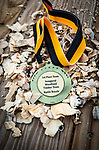 BEACON FALLS, CT-112020JS17—A medal for the first place team sits on a pile of wood chips following the Woodland Timber Team Battle Royal Friday at Woodland Regional High School.<br />  Jim Shannon Republican-American