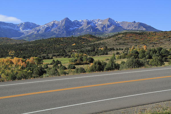 Highway with the Sneffels Range behind, San Juan Mountains, autumn, Colorado.