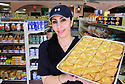 Gadir Haider shows of her Kolaj, fresh out of the oven at Stella Maris Restaurant and Grocery.