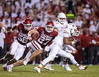 Arkansas LB Hayden Henry (27)<br /> with the tackle of University of Texas QB Casey Thompson (11)<br />Donald W. Reynolds Razorback Stadium, Fayetteville, AR, on Saturday, September 11, 2021 /  David Beach