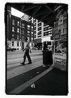 1987 File Photo - Montreal (Qc) Canada - a man walk past poster on outside Guy metro station