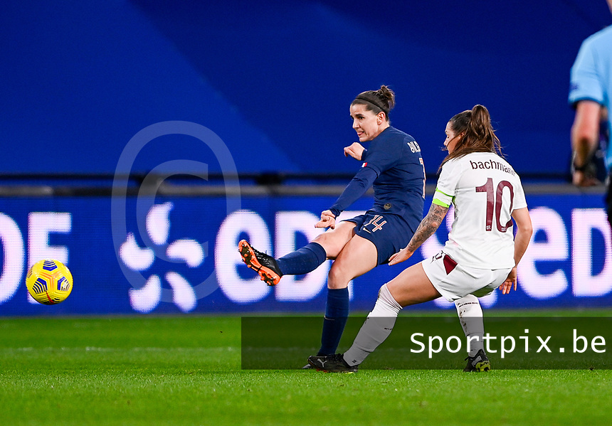 French Charlotte Bilbault (14) pictured in a duel with Swiss Ramona Bachmann (10) during the Womens International Friendly game between France and Switzerland at Stade Saint-Symphorien in Longeville-lès-Metz, France.