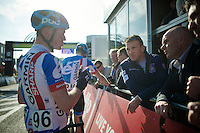 former rider/legend Johan Museeuw (BEL) listening to Nick Nuyens' (BEL/Garmin-Sharp) race recap at the finish<br /> <br /> 102nd Scheldeprijs 2014