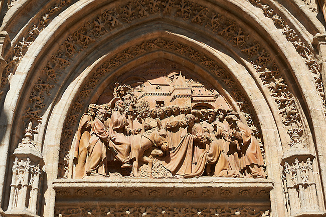 Christ's Entry into Jerusalem by Lope Marin in 1548 on the Gothic Puerta de Campanilla entrance door of the Cathedral of Seville, Spain