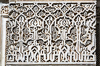 Meknes, Morocco.  Medersa Bou Inania, 14th. Century.  Floral Design and Calligraphy in Stucco.