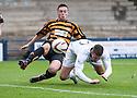 Raith Rovers' Calum Elliot gets in front of Alloa's Jason Marr to head home their third goal.