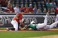 Logan Sherer (25) of the Charlotte 49ers is tagged out by Mitchell Webb (6) of the Georgia Bulldogs as he slides into third base at BB&T Ballpark on March 8, 2016 in Charlotte, North Carolina. The 49ers defeated the Bulldogs 15-4. (Brian Westerholt/Four Seam Images)