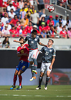 Orlando, Florida - Saturday, June 04, 2016: Paraguayan midfielder Celso Ortiz (16) goes up high to win a header in front of Costa Rican midfielder Bryan Ruiz (10) and Paraguayan forward Robert Piris Da Motta (23) during a Group A Copa America Centenario match between Costa Rica and Paraguay at Camping World Stadium.