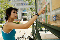Model Released photo of a 21 year old asian (Chinese Filippina) looking for direction at Victoria's Square<br /> in Montreal, Canada<br /> <br /> photo : Roussel  - Images Distribution