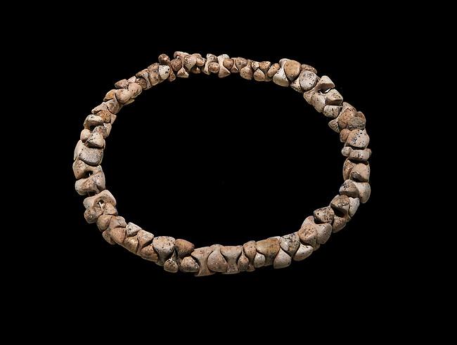 Bone necklace. Catalhoyuk Collections. Museum of Anatolian Civilisations, Ankara. Against a black background