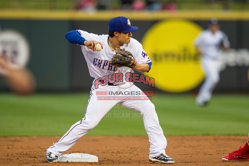 Round Rock Express second baseman Thomas Field (2) turns a double play during Pacific Coast League game against the Memphis Redbirds on April 21, 2015 at the Dell Diamond in Round Rock, Texas. Round Rock defeated Memphis 2-1. (Andrew Woolley/Four Seam Images)