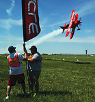 Piqua resident Keith Luce and his son had the honor of holding one of the poles for Sean D.Tucker for his famous triple ribbon cut at the Vectren Dayton Air Show. Tucker first flies under the ribbons before using his Oracle Challeger III aircraft, flying at more than 200 mph, to cut the ribbons as he flies down flight line.