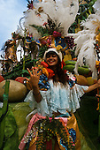 Rio de Janeiro, Brazil. Samba dancers during the carnival parade; Carmen Miranda fruit headdress theme.