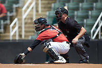 Piedmont Boll Weevils catcher Michael Hickman (37) reaches for a pitch in the dirt as home plate umpire Tanner Moore looks on during the game against the Greensboro Grasshoppers at Kannapolis Intimidators Stadium on June 16, 2019 in Kannapolis, North Carolina. The Grasshoppers defeated the Boll Weevils 5-2. (Brian Westerholt/Four Seam Images)