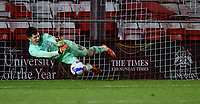 Manchester City U21's Cieran Slicker saves a penalty taken by Lincoln City's James Jones in the penalty shoot out<br /> <br /> Photographer Chris Vaughan/CameraSport<br /> <br /> EFL Papa John's Trophy - Northern Section - Group E - Lincoln City v Manchester City U21 - Tuesday 17th November 2020 - LNER Stadium - Lincoln<br />  <br /> World Copyright © 2020 CameraSport. All rights reserved. 43 Linden Ave. Countesthorpe. Leicester. England. LE8 5PG - Tel: +44 (0) 116 277 4147 - admin@camerasport.com - www.camerasport.com