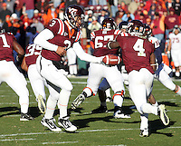 Nov 27, 2010; Charlottesville, VA, USA;  Virginia Tech Hokies quarterback Logan Thomas (3) hands off the ball to Virginia Tech Hokies running back David Wilson (4) during the game at Lane Stadium. Virginia Tech won 37-7. Mandatory Credit: Andrew Shurtleff