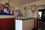 Stamford AFC 2 Marine 4, 29/03/2014. Wothorpe Road, Northern Premier League. The Stamford Tea lady poised for a busy afternoon ahead of The Northern Premier League game between Stamford AFC and Marine from The Daniels Stadium. Marine won the game 4-2 in front of 320 supporters to boost their chances of relegation survival. Stamford AFC are moving to the brand new Zeeco Stadium at the end of the 2013/14 season Photo by Simon Gill.