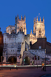 Great Britain, England, Yorkshire, York: Bootham Bar medieval gate and city walls with York Minster at night