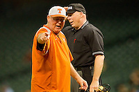 Texas Longhorns head coach Augie Garrido #16 argues a call with home plate umpire Dave Yeast during the game against the Rice Owls at Minute Maid Park on March 2, 2012 in Houston, Texas.  The Longhorns defeated the Owls 11-8.  Brian Westerholt / Four Seam Images