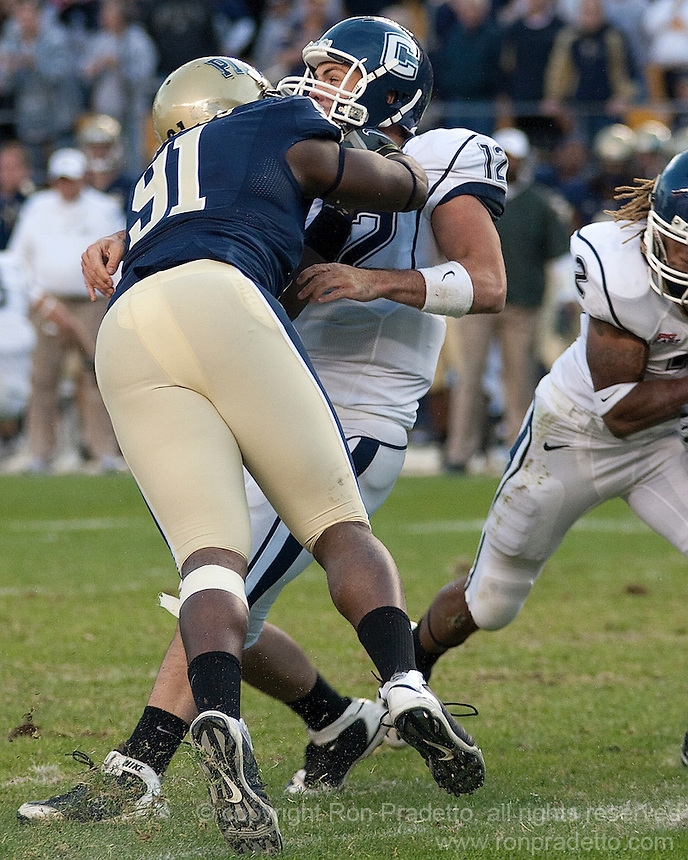 Pittsburgh defensive lineman Greg Romeus hits UConn quarterback Cody Endres. Pittsburgh Panthers defeat the University of Connecticut Huskies 24-21 on October 10, 2009 at Heinz Field, Pittsburgh, PA.