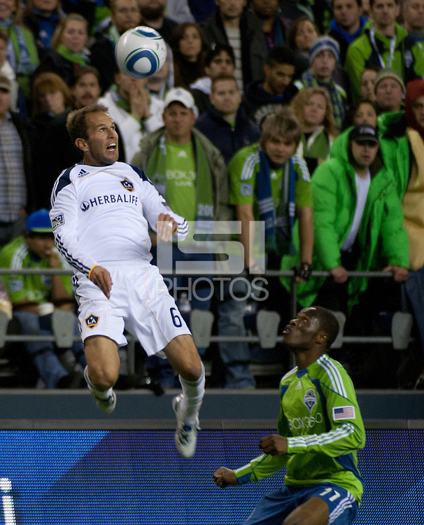 Eddie Lewis(6) of the Los Angeles Galaxy goes for a header aginst Steve Zakuani (11) of the Seattle Sounders in the first game of the 2010 MLS Playoffs at the XBox 360 Pitch at Quest Field in Seattle, WA on October 31, 2010. The Galaxy defeated the Sounders 1-0.