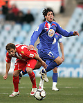 Getafe's Daniel Parejo against Almeria's Miguel Garcia Corona during La Liga match. February 14, 2010. (ALTERPHOTOS/Alvaro Hernandez).