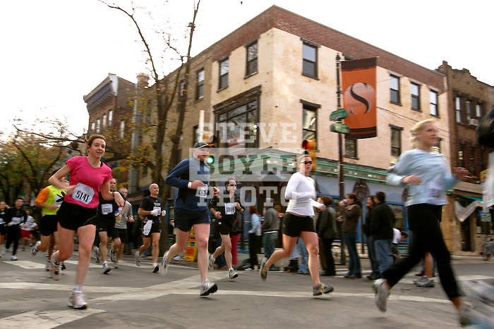 Runners cross the intersection of 4th and South Street during the Philadelphia Marathon in Philadelphia, Pennsylvania on November 19, 2006.