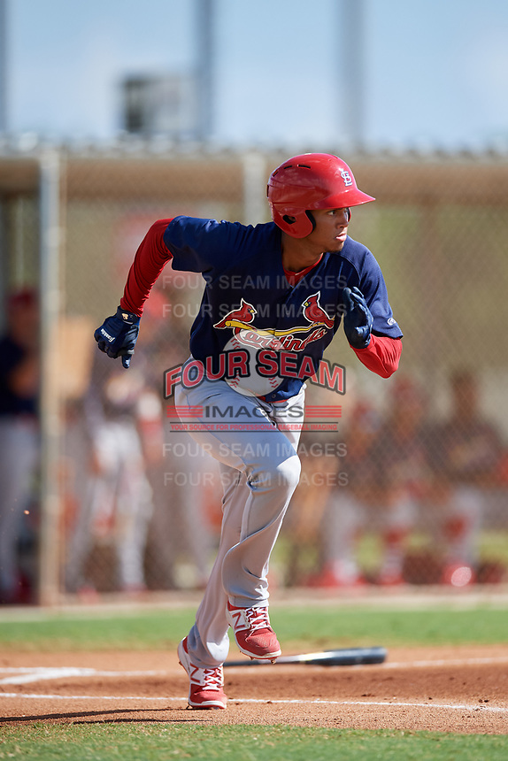 GCL Cardinals right fielder Jhon Torres (33) runs to first base during a game against the GCL Marlins on August 4, 2018 at Roger Dean Chevrolet Stadium in Jupiter, Florida.  GCL Marlins defeated GCL Cardinals 6-3.  (Mike Janes/Four Seam Images)