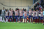 Atletico de Madrid's players observe a minute of silence in memory of the victims ef the earthquake in Haiti during La Liga match. January 17, 2010. (ALTERPHOTOS/Alvaro Hernandez).