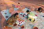 Auroville, India - April 2021: Human Unity in Covid Time. Creating a kolam in the Matrimandir amphiteater for Mother's birthday.