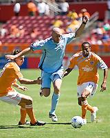 Colorado Rapids forward Conor Casey (9) splits Houston Dynamo defender Geoff Cameron (20) and Houston Dynamo midfielder Ricardo Clark (13).  Houston Dynamo defeated Colorado Rapids 1-0 at Robertson Stadium in Houston, TX on April 19, 2009.