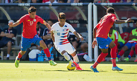 CARSON, CA - FEBRUARY 1: Ulysses Llanez Jr #19  of the United States moves with the ball past Yeltsin Tejeda #17 of Costa Rica during a game between Costa Rica and USMNT at Dignity Health Sports Park on February 1, 2020 in Carson, California.