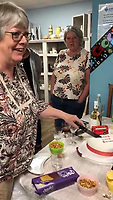 BNPS.co.uk (01202 558833)<br /> Pic: PennyIbbott/BNPS<br /> <br /> Pictured: Penny cutting a cake with the message 'Good Luck Boomer' earlier this month.<br /> <br /> Second time lucky...<br /> <br /> An intrepid pensioner has restarted her mission to travel around England on her free bus pass for charity 18 months after she had to cancel due to Covid.<br /> <br /> Grandmother Penny Ibbott was 16 days into her journey in March last year when Boris Johnson announced that people should stop any non-essential travel as the pandemic hit.<br /> <br /> The 75-year-old was devastated to call it off after months of planning, but has not let it beat her and has now set off to do the whole route again.
