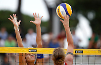 Brazil's Talita Antunes, left, in action against Germany's Britta Buthe at the Beach Volleyball World Tour Grand Slam, Foro Italico, Rome, 22 June 2013. Brazil defeated Germany 2-1.<br /> UPDATE IMAGES PRESS/Isabella Bonotto
