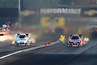Aug. 30, 2013; Clermont, IN, USA: The father/daughter NHRA funny car drivers John Force (left) races alongside Courtney Force during qualifying for the US Nationals at Lucas Oil Raceway. Mandatory Credit: Mark J. Rebilas-