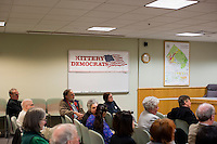 People listen as Shenna Bellows, Democratic candidate in Maine for US Senate, speaks to the Kittery Democrats town caucus in the Town Hall Council Chambers in Kittery, Maine, USA, on March 3, 2014. Bellows is trying to unseat incumbent Maine Republican Senator Susan Collins in the 2014 election. The town caucus had speeches from various other local candidates and also served to choose delegates for the 2014 Maine State Democratic Caucus.