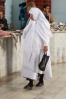Tripoli, Libya - Libyan Woman Wearing Traditional Furashiya in Fish Market, Rashid Street.