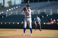 Surprise Saguaros relief pitcher Grant Gavin (54), of the Kansas City Royals organization, gets ready to deliver a pitch during an Arizona Fall League game against the Scottsdale Scorpions at Scottsdale Stadium on October 26, 2018 in Scottsdale, Arizona. Surprise defeated Scottsdale 3-1. (Zachary Lucy/Four Seam Images)