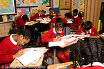 K-8 Parochial School Bronx New York Grade 5 students at work in classroom horizontal
