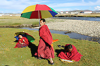 Young Tibetan monks in the town of Sershul on the Tibetan Plateau, in western China. The town is home to a large monastery which houses thousands of monks. The Sanjiangyuan or Three Rivers Headwater region of western China contains the sources of the Yangtze, Mekong and Yellow Rivers.