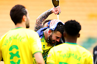 1st May 2021; Carrow Road, Norwich, Norfolk, England, English Football League Championship Football, Norwich versus Reading; Champagne is poured over Grant Hanley of Norwich City after winning the EFL championship