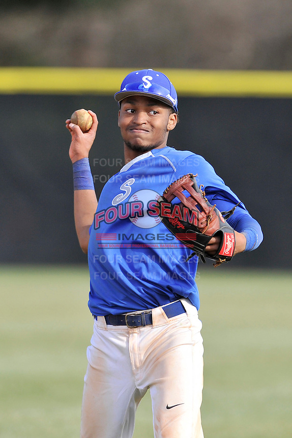 Center fielder Dominique Jackson (16) of the Spartanburg Methodist College Pioneers warms up before in a junior college game against Surry Community College on January 31, 2016, at Mooneyham Field in Spartanburg, South Carolina. (Tom Priddy/Four Seam Images)