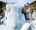 26/02/18As the Beast from the East sweeps in, hikers, Chloe Kirkpatrick and Ben Lester, brave sub-zero temperatures as they cross over a frozen waterfall and Lady Clough Moor in the Derbyshire Peak District near GlossopAll Rights Reserved - F Stop Press. www.fstoppress.com. Tel: +44 (0)1335 300098