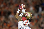 Despite thje efforts Auburn cornerback Chris Davis, Seminole wide receiver Kelvin Benjamin comes down the game winning touchdown with 13 seconds left in the BCS national title game at the Rose Bowl in Pasadena, California on January 6, 2014.  Florida State Seminoles defeated the Auburn Tigers 34-31.