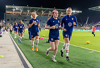 ORLANDO, FL - JANUARY 18: Rose Lavelle #16 and Emily Sonnett #14 of the USWNT leave the field after warmups before a game between Colombia and USWNT at Exploria Stadium on January 18, 2021 in Orlando, Florida.