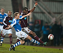 St Johnstone's Steven Anderson challenges Hearts' Michael Ngoo.