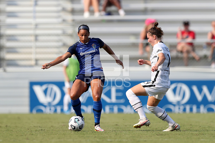 CARY, NC - SEPTEMBER 12: Lynn Williams #9 of the North Carolina Courage is defended by Natalia Kuikka #14 of the Portland Thorns FC during a game between Portland Thorns FC and North Carolina Courage at Sahlen's Stadium at WakeMed Soccer Park on September 12, 2021 in Cary, North Carolina.